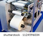 rotary die cutting machine with ... | Shutterstock . vector #1124596034