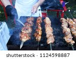 man's hands grilling meat and... | Shutterstock . vector #1124598887