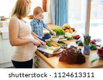 pregnant mother and son... | Shutterstock . vector #1124613311