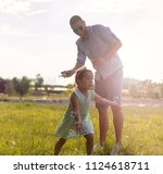 father and daughter are having... | Shutterstock . vector #1124618711