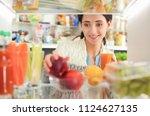 portrait of female standing... | Shutterstock . vector #1124627135