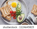 breakfast of coffee and fried... | Shutterstock . vector #1124645825