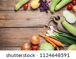 different raw vegetables over... | Shutterstock . vector #1124648591