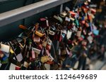 many locks of love on the... | Shutterstock . vector #1124649689