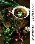 fresh chicken soup on wooden... | Shutterstock . vector #1124654774