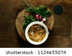 fresh chicken soup on wooden... | Shutterstock . vector #1124655074