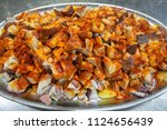 huge tray with octopus slices ... | Shutterstock . vector #1124656439