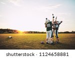 ecstatic group of american... | Shutterstock . vector #1124658881