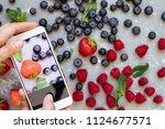 photographing food. hands... | Shutterstock . vector #1124677571