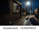 dark  gritty and wet industrial ... | Shutterstock . vector #1124694014