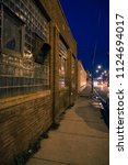 dark  gritty and wet industrial ... | Shutterstock . vector #1124694017