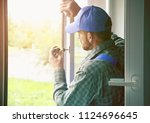 service man installing window... | Shutterstock . vector #1124696645