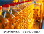 sunflower oil. factory line of... | Shutterstock . vector #1124704064