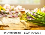 bottle with aroma oil and... | Shutterstock . vector #1124704217