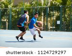 young asian male basketball... | Shutterstock . vector #1124729297