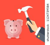 breaking piggy bank. human hand ... | Shutterstock .eps vector #1124739584