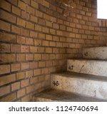 circular concrete staircase... | Shutterstock . vector #1124740694