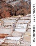 salt ponds  near cusco  peru | Shutterstock . vector #1124780054