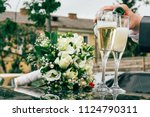 poring champagne from the... | Shutterstock . vector #1124790311