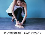young asian woman having ankle... | Shutterstock . vector #1124799149