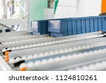 plastic boxes on the roller... | Shutterstock . vector #1124810261