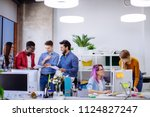 well lit white open office... | Shutterstock . vector #1124827247
