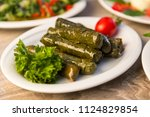 stuffed leaves on the plate...   Shutterstock . vector #1124829854