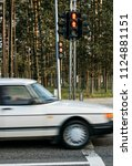 car and traffic light with red... | Shutterstock . vector #1124881151