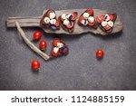 bruschetta with mozzarella and... | Shutterstock . vector #1124885159