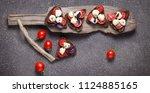 bruschetta with mozzarella and... | Shutterstock . vector #1124885165