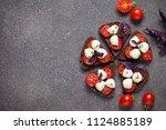 bruschetta with mozzarella and... | Shutterstock . vector #1124885189