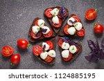 bruschetta with mozzarella and... | Shutterstock . vector #1124885195