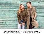fashion couple standing posing... | Shutterstock . vector #1124915957