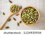 Pumpkin Seeds In Wooden Bowl...
