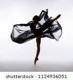 A ballerina dances with a black ...