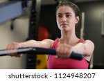 woman in gym exercising on...   Shutterstock . vector #1124948207