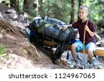 young cute child boy with stick ... | Shutterstock . vector #1124967065