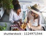 two woman sharing healthy vegan ... | Shutterstock . vector #1124971544