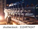 beer tap in the row in beer bar | Shutterstock . vector #1124974247