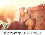 young man on training break... | Shutterstock . vector #1124974334