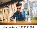 stressed male feeling headache... | Shutterstock . vector #1124991704