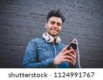 half length portrait of smiling ...   Shutterstock . vector #1124991767