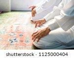 muslim men praying in tashahhud ... | Shutterstock . vector #1125000404