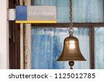 closeup sign station master... | Shutterstock . vector #1125012785