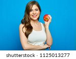 smiling woman holding red apple.... | Shutterstock . vector #1125013277