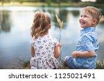 your happy couple of kids  boy...   Shutterstock . vector #1125021491