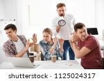 angry boss with megaphone... | Shutterstock . vector #1125024317