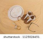 a set of bright summer clothes... | Shutterstock . vector #1125026651