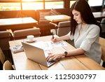 close up the hand of an asian... | Shutterstock . vector #1125030797
