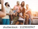 group of happy friends having... | Shutterstock . vector #1125033947